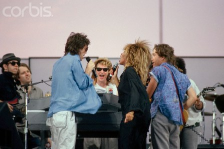 1985 --- Mick Jagger of the Rolling Stones and singer Tina Turner rehearse for Live Aid with Daryl Hall and G.E. Smith. Live Aid is a benefit concert to provide relief for famine victims in Ethiopia. --- Image by © Lynn Goldsmith/CORBIS